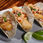 Triple 'M' Tacos: Our mahi mahi tacos are becoming a huge hit with customers and staff!