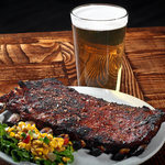 We barbecue our ribs, a process of how they're cooked, not just smothered in sauce!  But, our sa