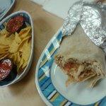 Chicken burrito and nachos with salsa
