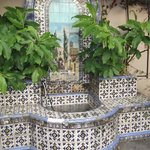 traditional garden fountain creates an attractive centerpiece in the garde/dining area