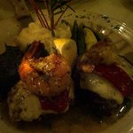 Filet mignon medallions topped with mozzarella, roasted peppers and shrimp