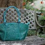 Hand-tooled leather handbag