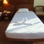 bed with towel's cranes