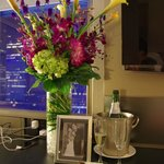 Flowers, champagne, chocolate covered strawberries, and a photo of our wedding(just supplied my