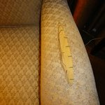 In room arm chairs, both chairs, both arms horrible condition, old worn, torn