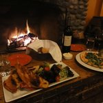 Great meal in front of the fireplace in the main lodge