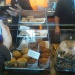 taking order over the baked goods with no covering.. talking over them and all ..yuk