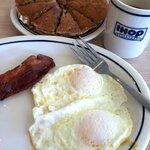 eggs over med, crisp bacon, harvest grain n but cakes.