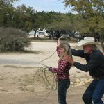 Cowboy Larry showing how to throw a lasso.