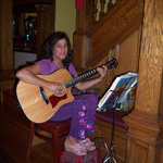 our local singer entertains guests at dinner