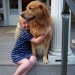 resident therapy golden gets a hug from a little guest