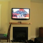 big TV and fireplace