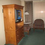 Sitting area and TV in armoire