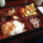 Osaka bento box- beef teriyaki, salad, rice with sauce, and yam sushi