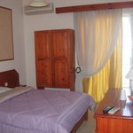 typical room with A/C, TV , refrigerator,  private bath, balcony,