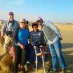 Guest enjoying camel ride at dunes