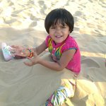 Kid playing wid sand