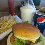 Absolutely Delishious Burger, Fries, Ice cold Pepsi and a Creamy Vanilla Milkshake!