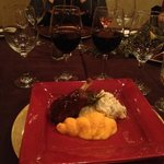pork with mashed potatoes and two of the red wines