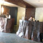 Reception desks made of trees which were brought down in a typhoon.