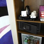 Safe, mini-bar, and coffee/tea.
