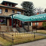 Look for Canino's long green awning