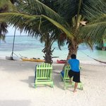 son getting a rest after lots of diving , snorkeling, fishing