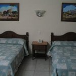 Double beds with Mayan folk art paintings