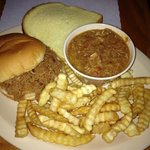 barbeque pork sandwich, french fries, and brunswick stew