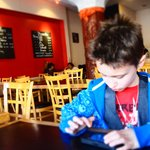 My little guy at Zen Yai.  Notice the Thai language blackboard items that are not listed on the