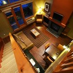 Looking down from loft to living room/ kitchenette