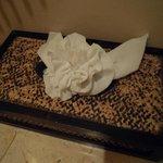 Tissue paper folded into flower shape (same for toilet roll & kitchen paper)