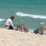Local food provider cooks corn etc on the beach.