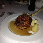 Veal chop with with boar bacon and fontina cheese.