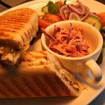 A Chicken Pesto Panini served with homemade coleslaw and salad