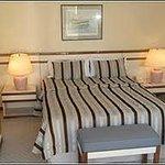 Quarto cama confortável