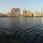 panorama of creek - floating restaurant against cityscape