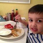 little man lovin' his pancakes
