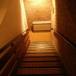 A 1990s stairwell - concrete, drab, dull, cold and with an antiquated heater!