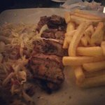 Grilled pork, fries, and cabbage salad