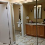 A dressing area features a large closet and an adjoining bathroom.