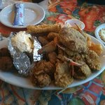 the fried seafood platter was about a foot high. it could easily serve two
