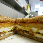 Bacon egg and cheese with a hash brown on ww toast