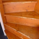 Wooden stairs to mezzanine, scraped, damaged, need protective edging
