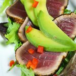 Seared bistec-rubbed tuna with honey-lime vinaigrette & avocado.