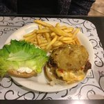 cheese burger topped with fried green tomato