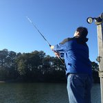 Husband fishing on dock