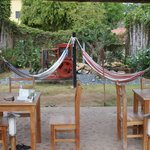 Tables and Chairs and hammocks in the yard