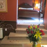 The Royal Treatment! Rose petals from doorway to bed.