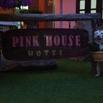 the pink house sign